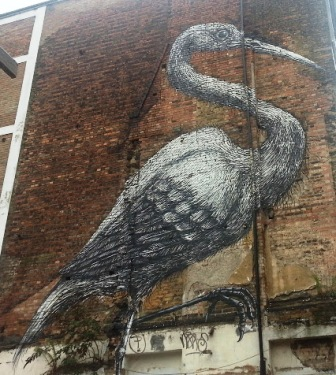 A large bird on a wall on the Spitalfields Safari.