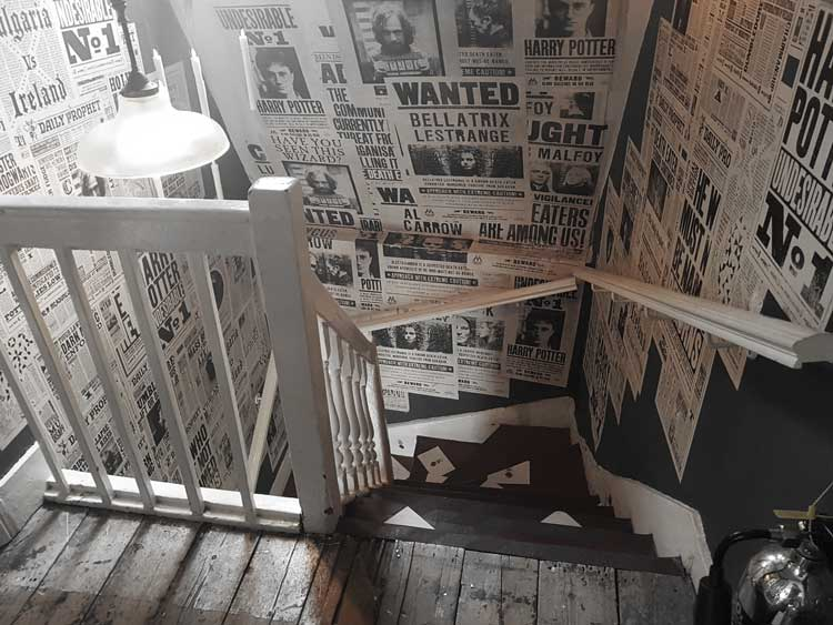 A staircase inside House of Minalima.