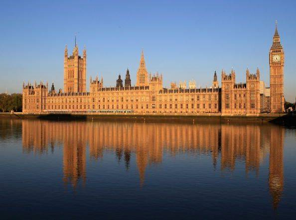 The Houses of Parliament seen from the River Thames.